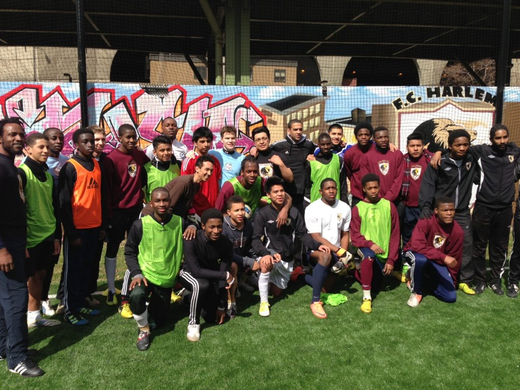 Phil Babb (center black adidas hoodie) poses with players and coaches of FC Harlem U19 Team