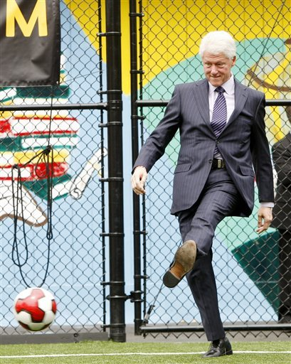 Former President Bill Clinton kicks a soccer ball during a news conference in New York, Monday, May 17, 2010. Clinton will serve as the honorary chairman of the United States' bid to host the 2018 or 2022 World Cup.  (AP Photo/Seth Wenig)