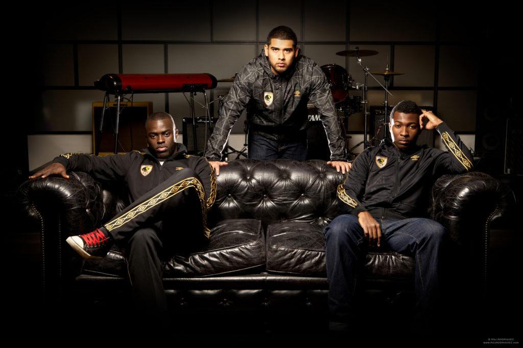 FC Harlem alumni and coaches modeling new range at UMBRO Showroom NYC.