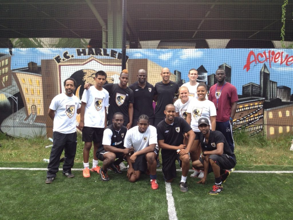 FC Harlem coaches and players pose with Tim Howard. L-R (back) Weusi Baraka, Francisco Larios, Corey Pierce,Irv Smalls, Tim Howard,Magnus Thompson,Kwaisi Ayisi,Lindsay Cunningham, Marquita Richards (front) Edmond Addison,Leo Estrada, Mark Anthony William and Anders Khan